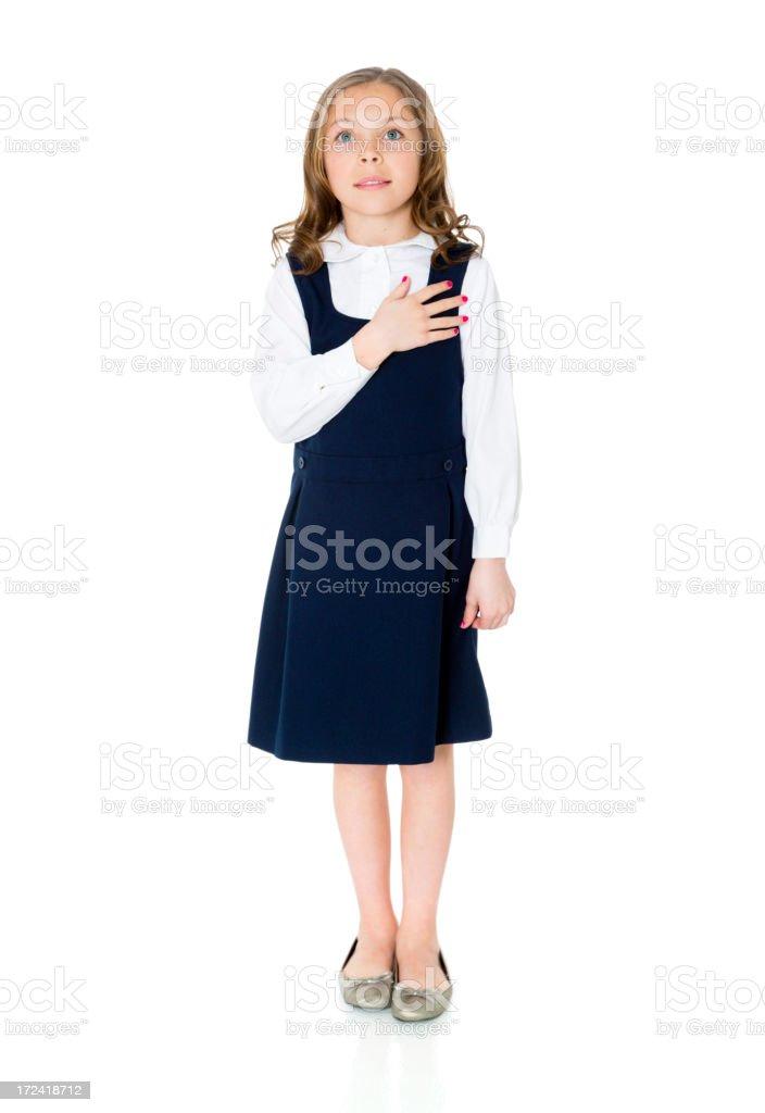 School Girl with Hand on Heart stock photo