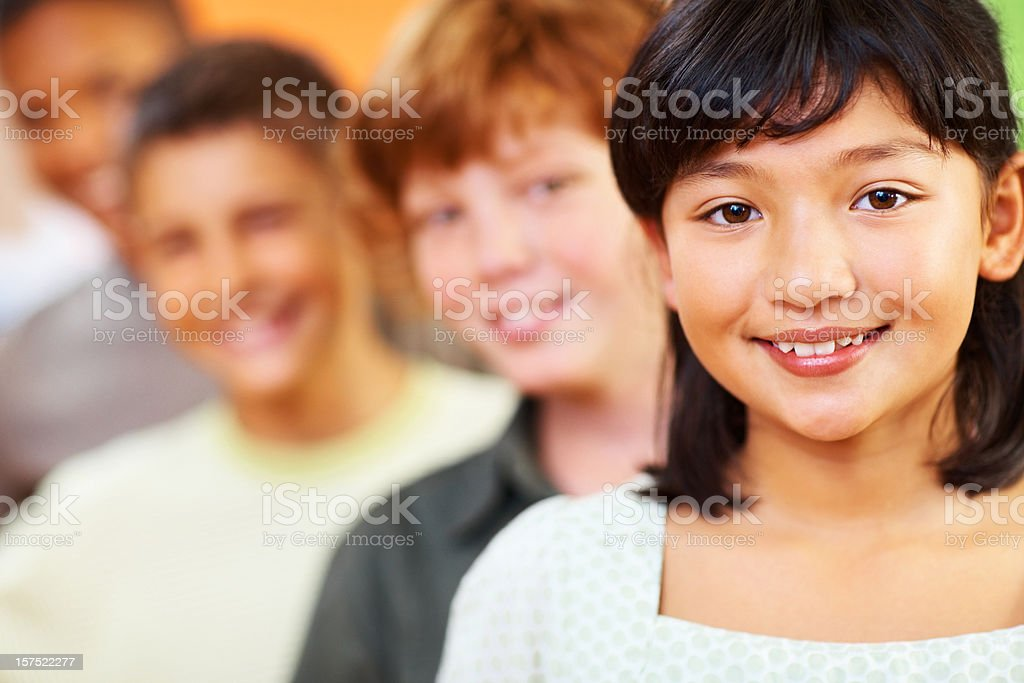 School girl with her classmates at the ack royalty-free stock photo