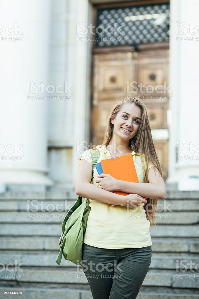 School girl with textbooks stock photo