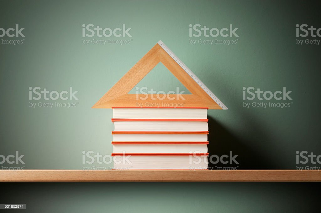 School. House shaped books and metric wooden triangle. stock photo