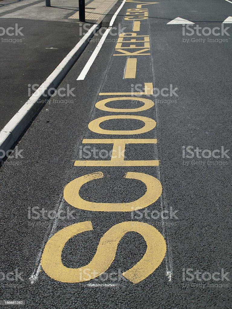 School Keep Clear markings in road outside UK school stock photo