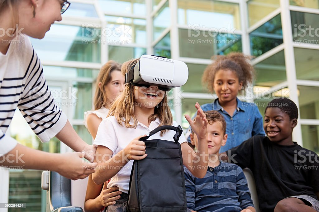 School Kids experimenting virtural reality stock photo