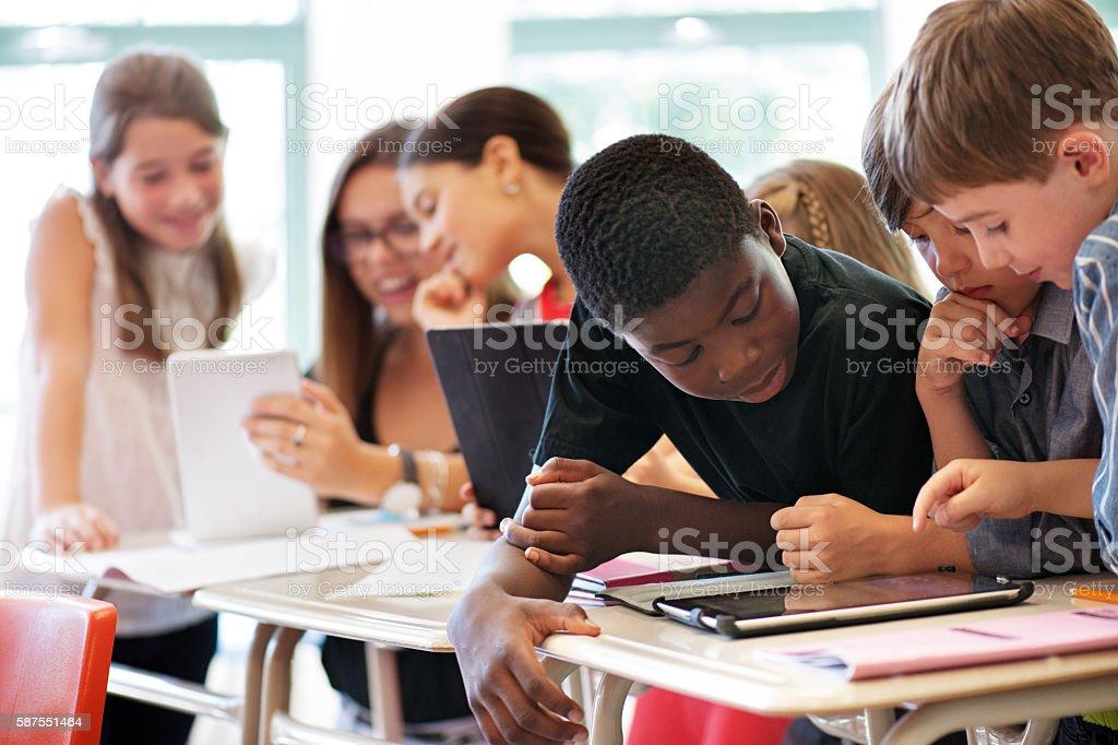 School kids in class using a digital tablet stock photo