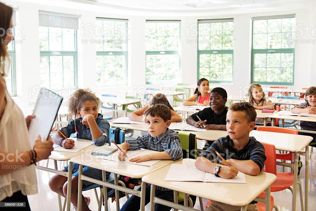 School kids in classroom stock photo