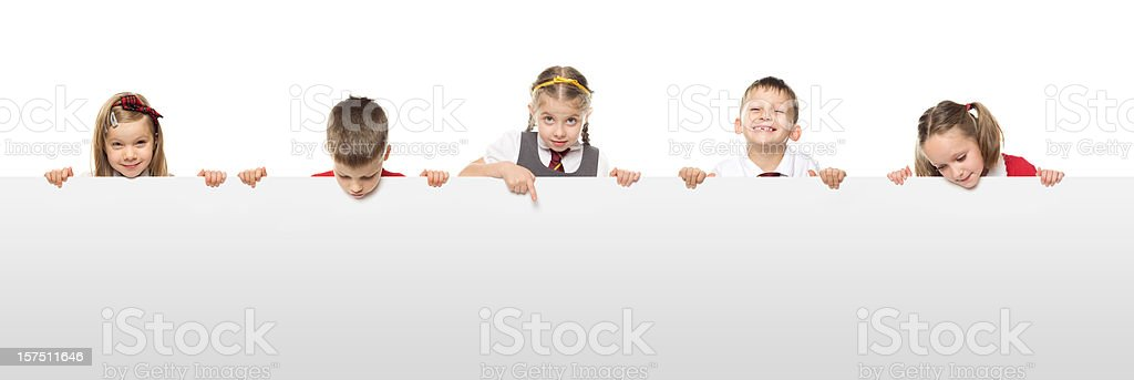 School Kids With A Blank White Board stock photo