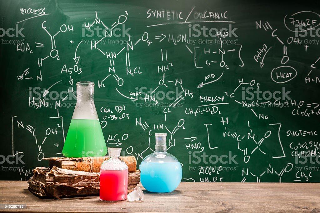School laboratory with books and beakers stock photo