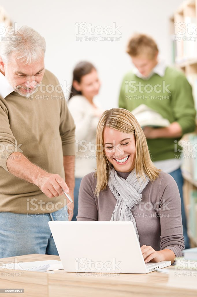 School library - happy student with professor royalty-free stock photo