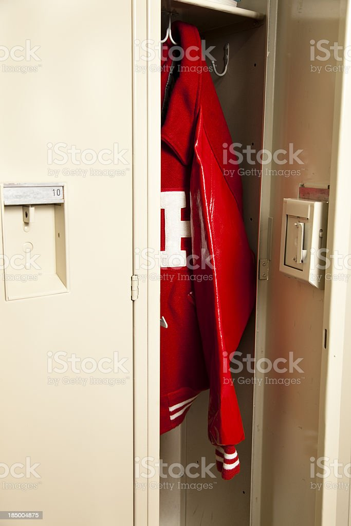 School locker with red letter jacket hanging inside stock photo