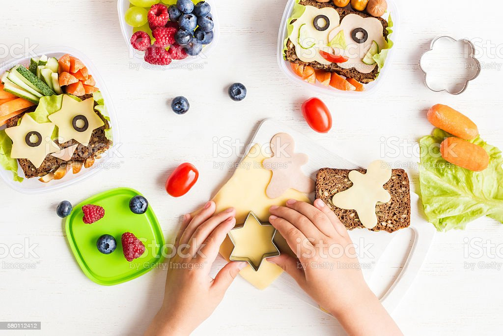 School lunch box for kids. Cooking. Child's hands. Flat lay stock photo