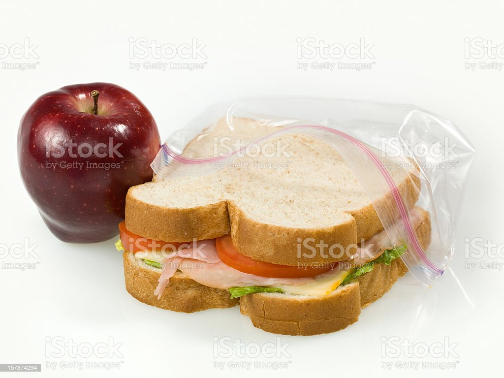 A School Lunch of an Apple and Sandwich stock photo
