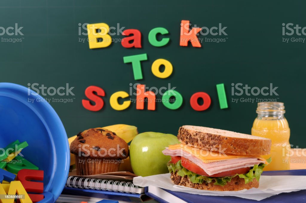 School lunch on a classroom table stock photo