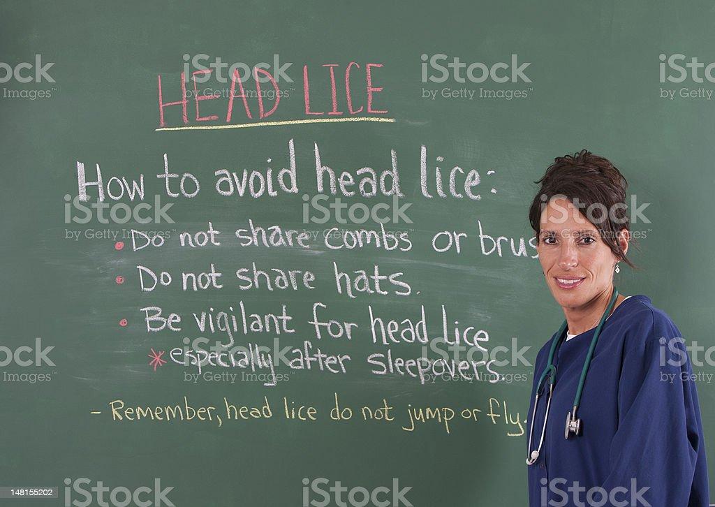 School nurse and head lice stock photo