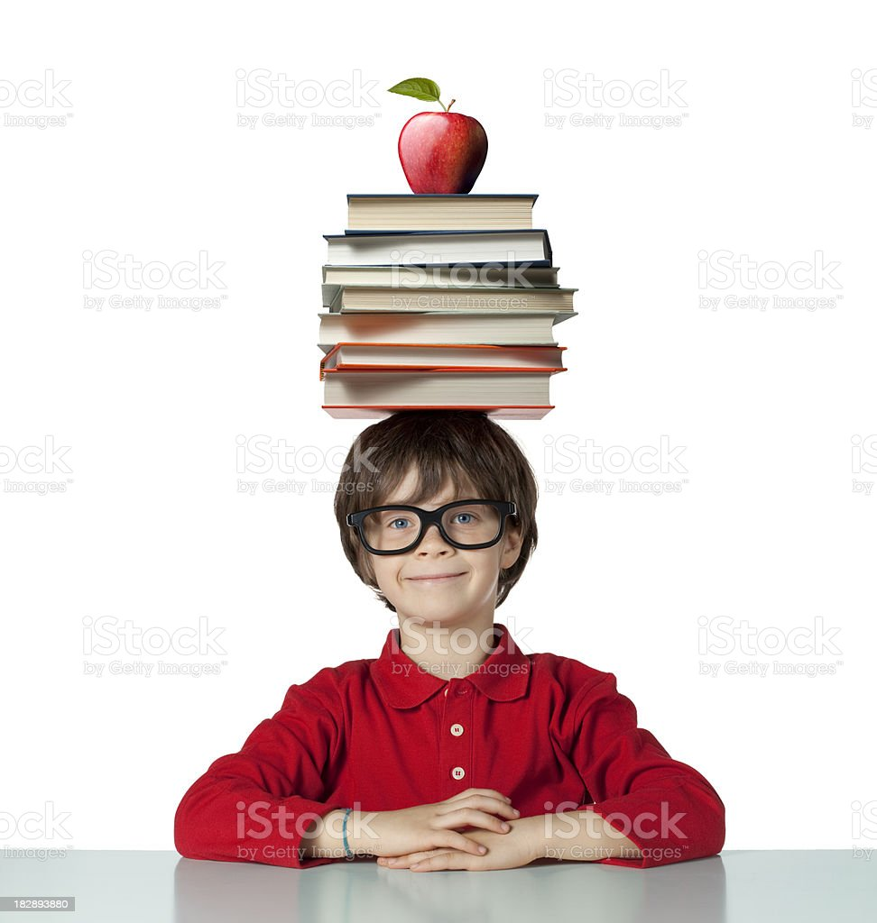 School pupil with pile of books on his head royalty-free stock photo