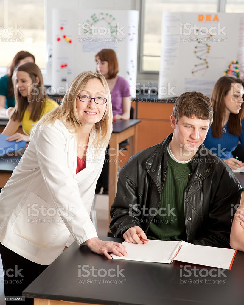 School Science: Teacher Instructing Students Learning Classroom royalty-free stock photo
