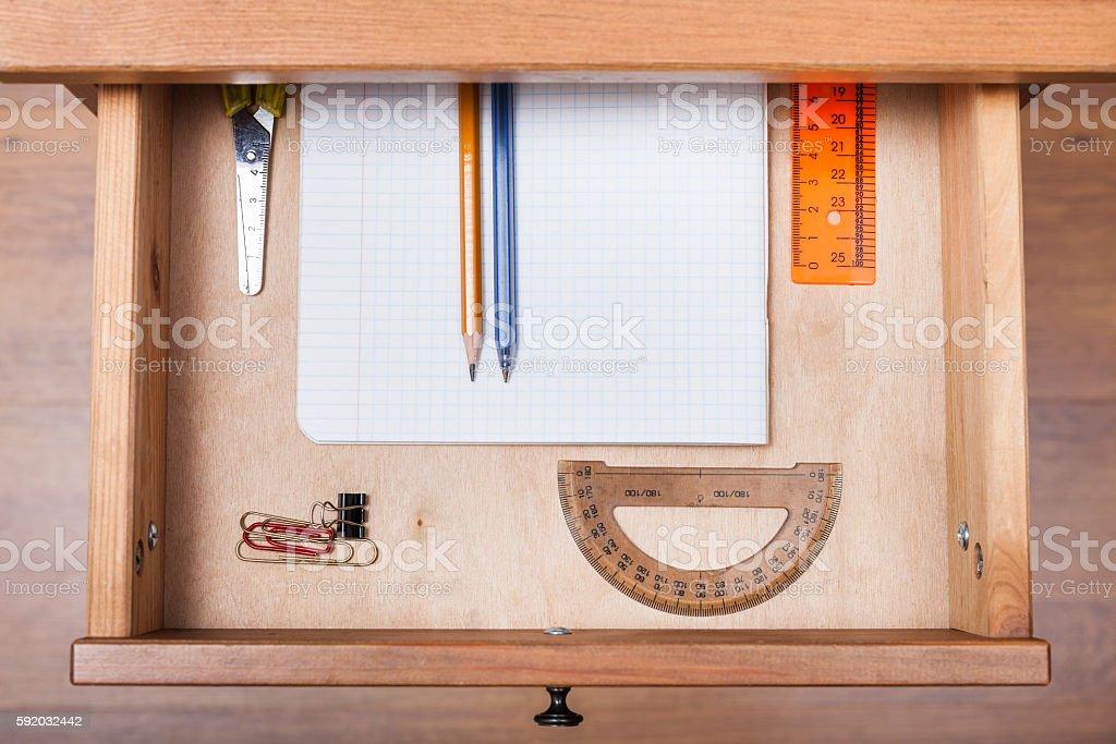 school set in open drawer stock photo