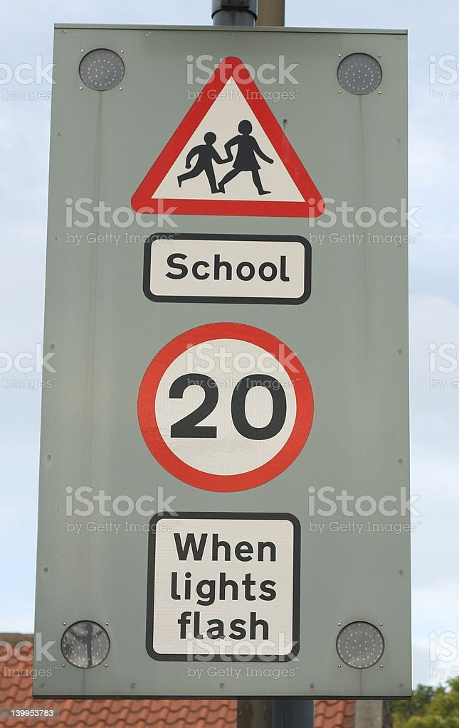 school sign, 20 mph speed limit when lights flash royalty-free stock photo