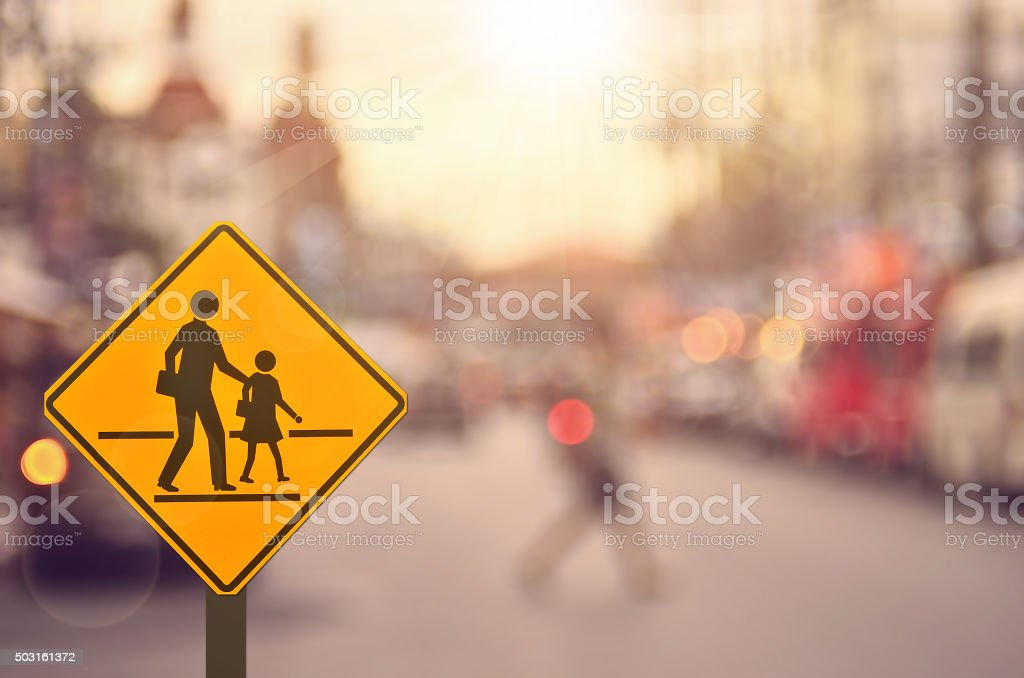 School sign on blur traffic road background. stock photo