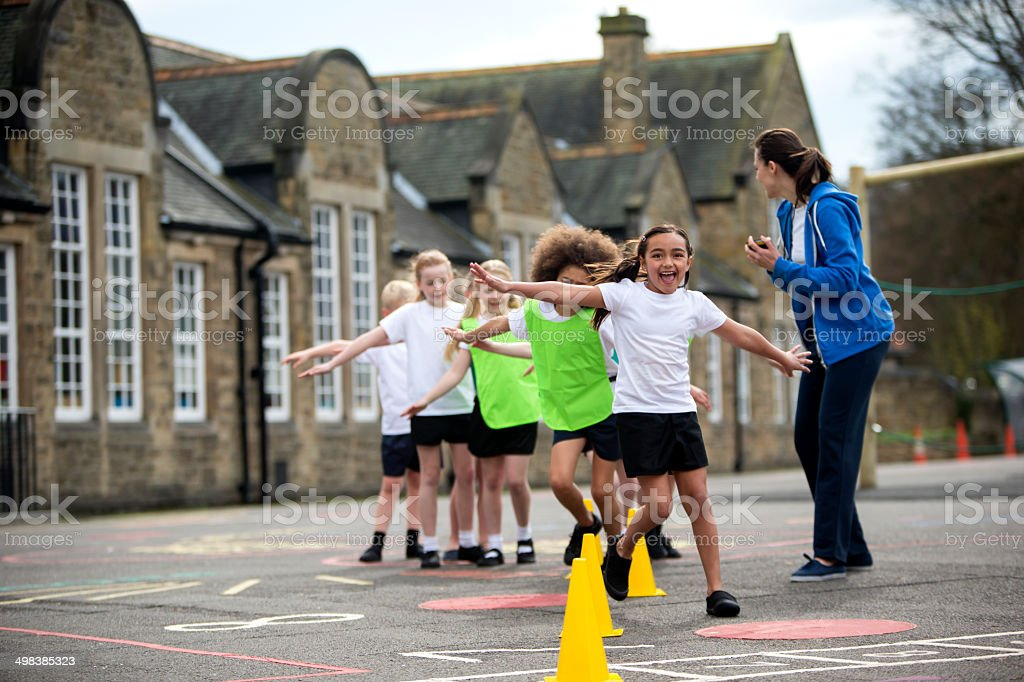 Children in the school playground during a physical education lesson....