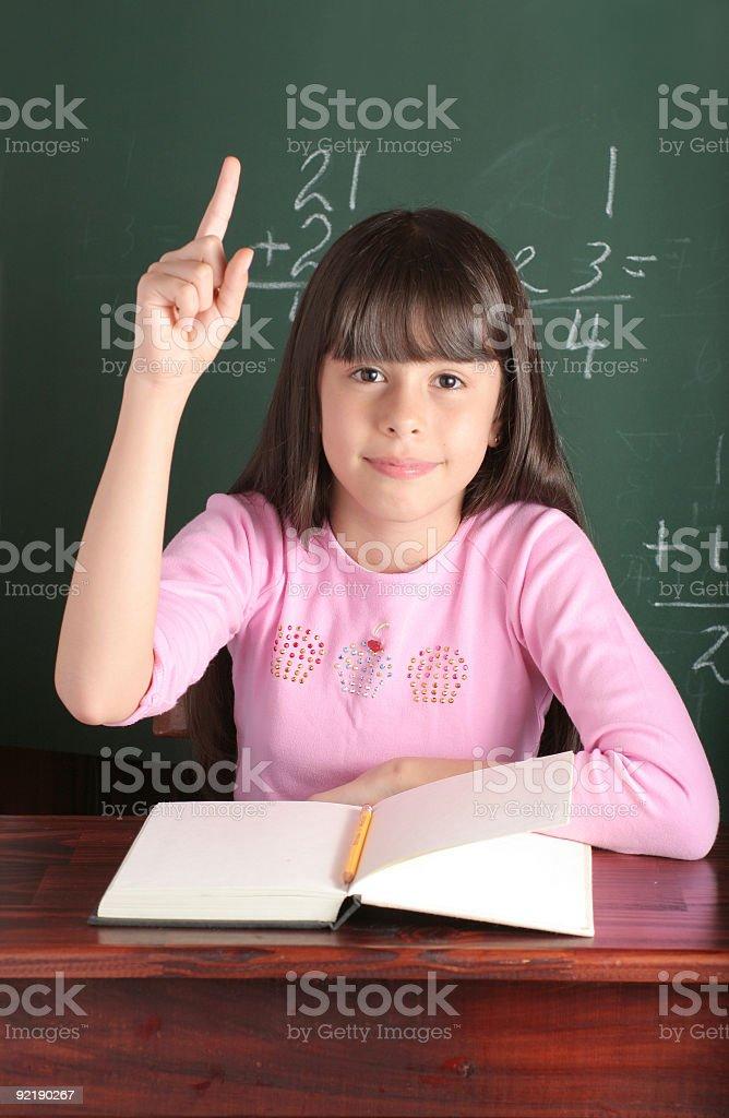 School student raising hand stock photo