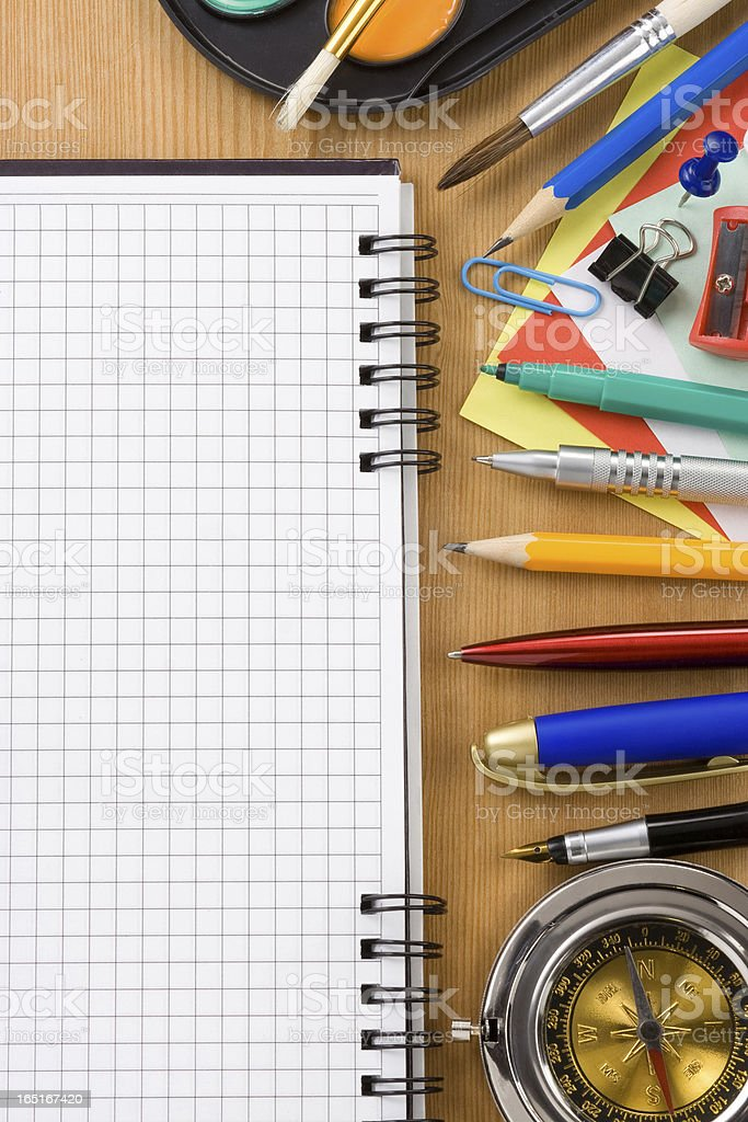 school supplies and checked notebook on wood royalty-free stock photo