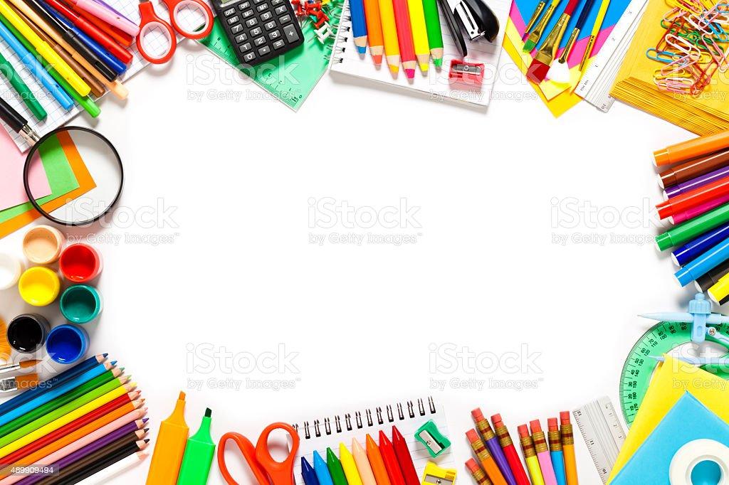 School supplies border against white background stock photo