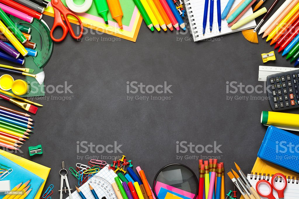 School supplies border on black chalkboard stock photo