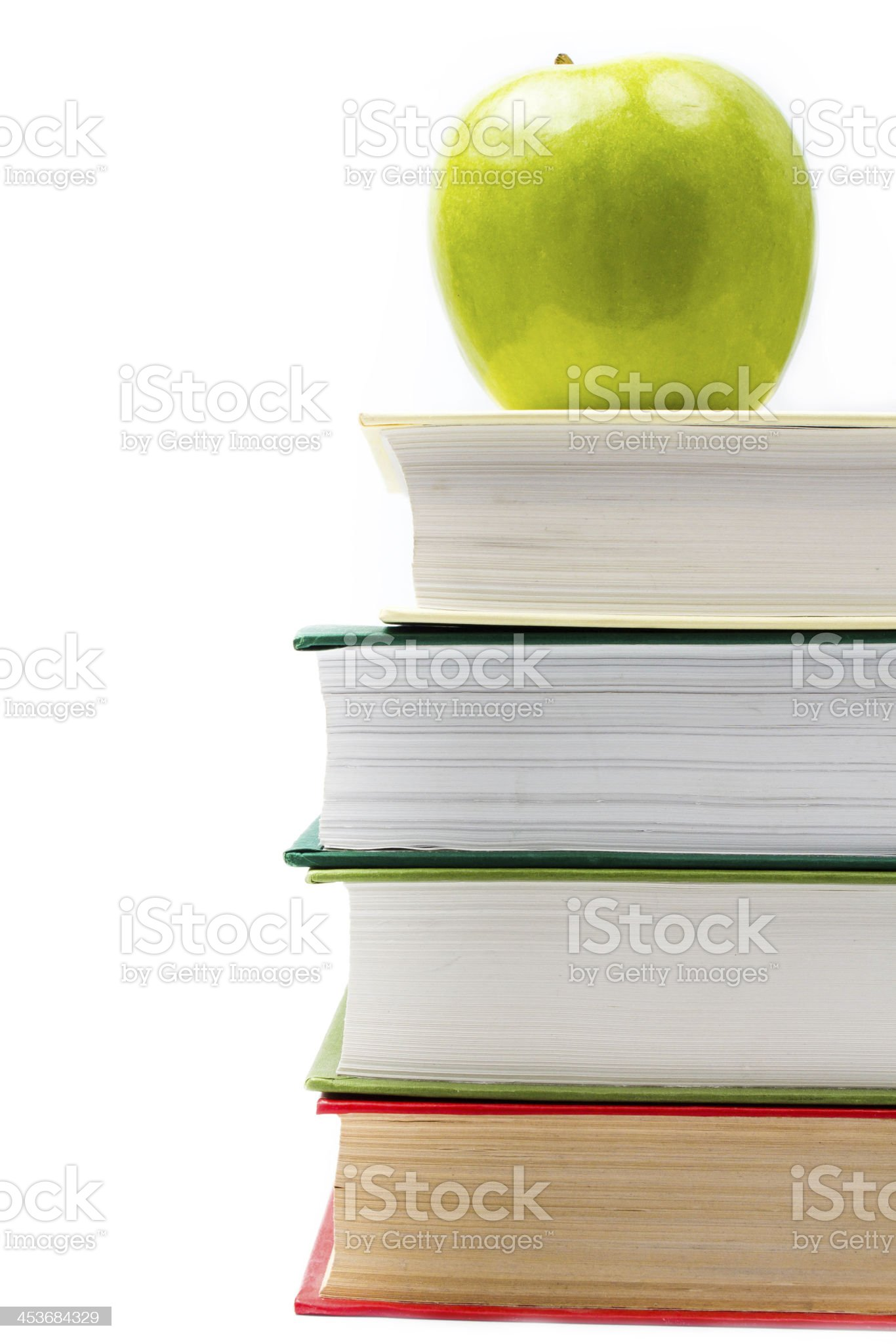 School supplies in classroom with books and apple royalty-free stock photo