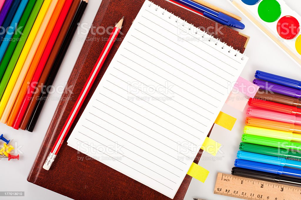 School supplies including markers, pens, pencils and paper royalty-free stock photo