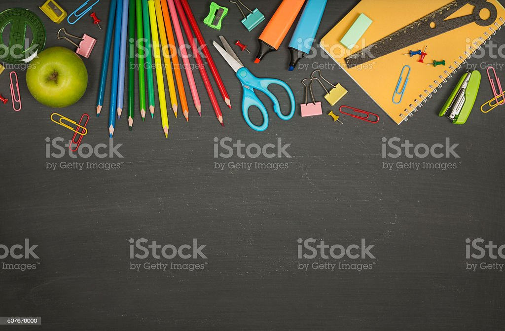 School supplies on a blackboard with copy space stock photo