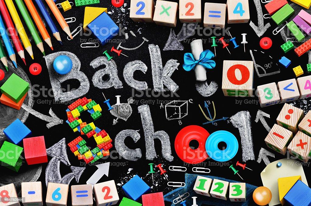 School supplies on black schoolboard background stock photo