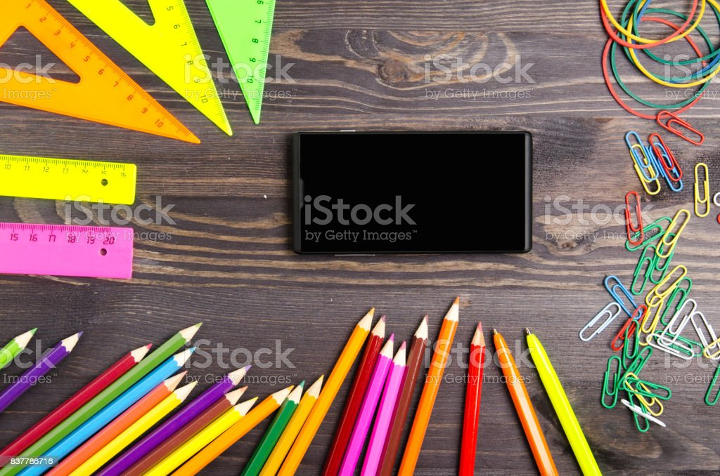 School supplies (pencil, pen, ruler, triangle) on blackboard background ready for your design .school supplies top view stock photo