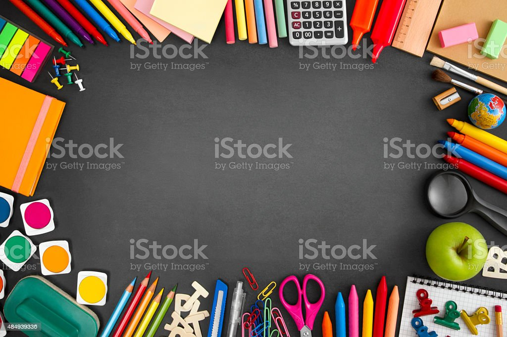 School Supplies on Blackboard stock photo
