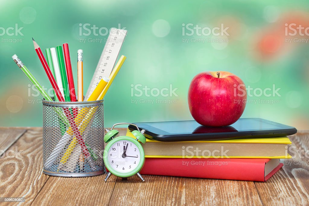 School supplies on green empty space background. stock photo