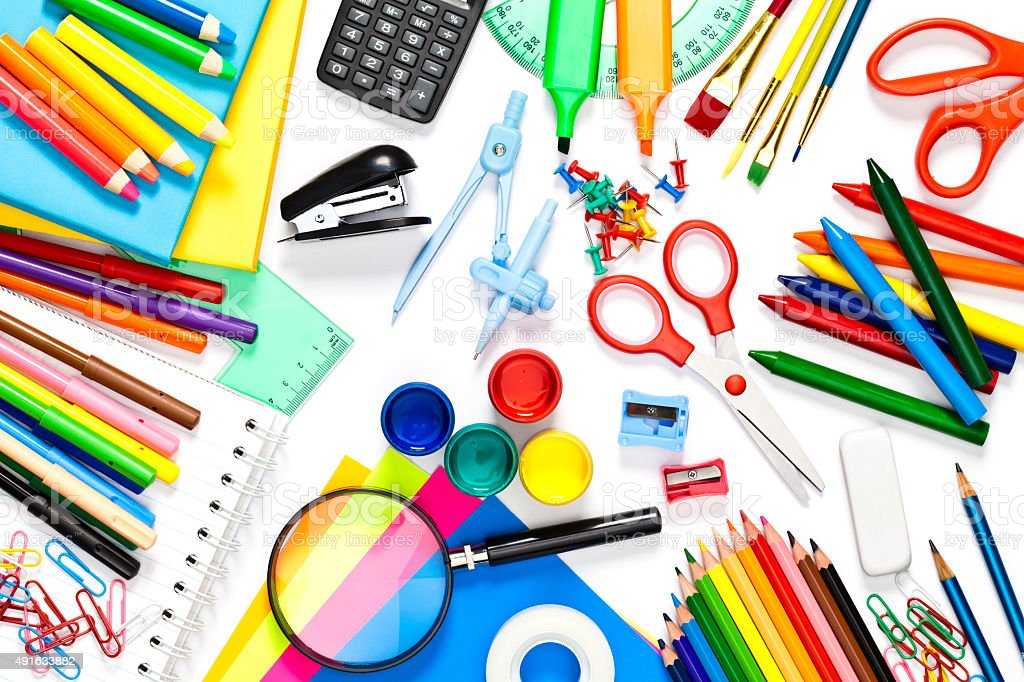 School supplies on white background shot directly above stock photo