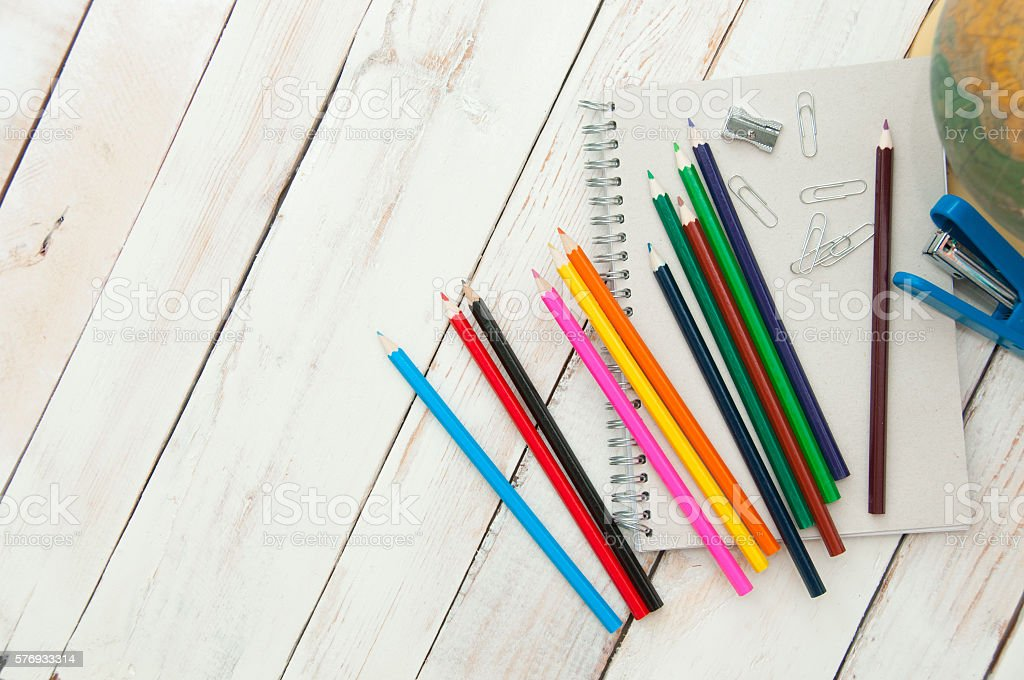School supplies on white wooden background stock photo