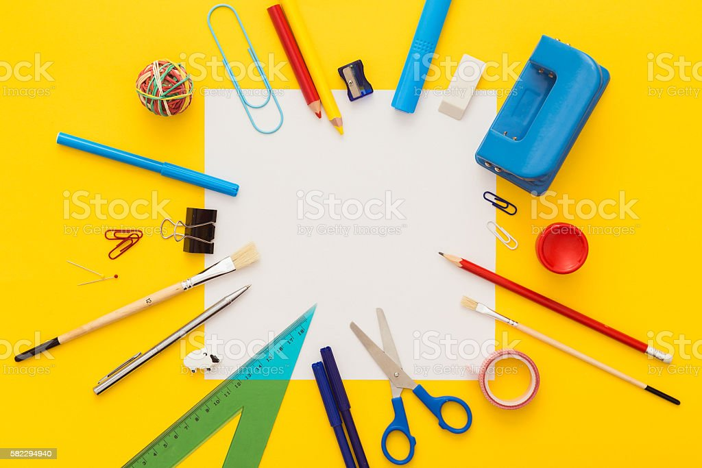 School supplies on yellow desk with copy space.Top view. stock photo