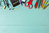 school supplies, stationery accessories on wood background.