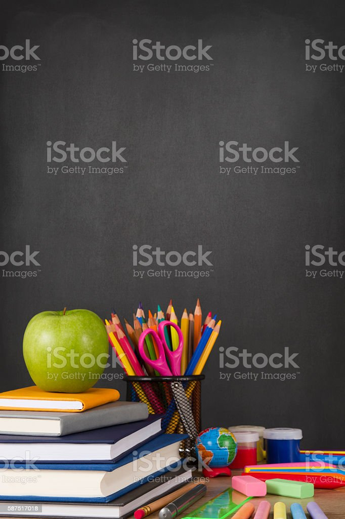 School Supplies with Apple and Chalkboard stock photo