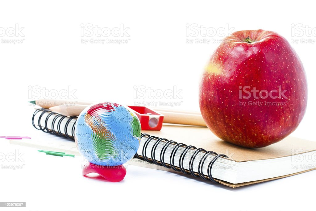 School supplies with Globe and notebook  on white background royalty-free stock photo