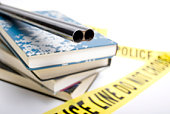 School Violence shotgun on top of schoolbooks