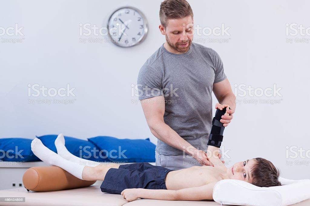 Schoolboy after wrist injury stock photo