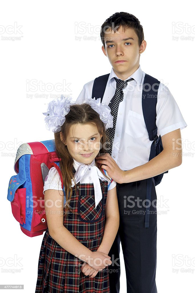 Schoolboy and schoolgirl  with school bags royalty-free stock photo