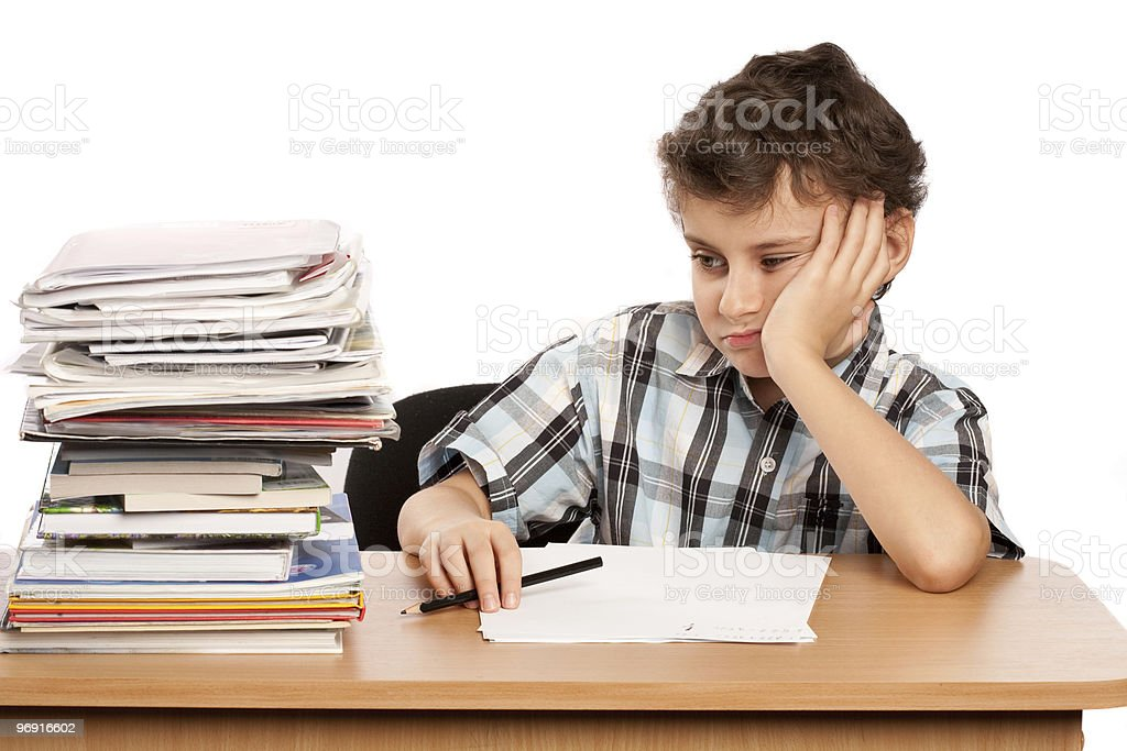 Schoolboy displeased by the amount of homework stock photo