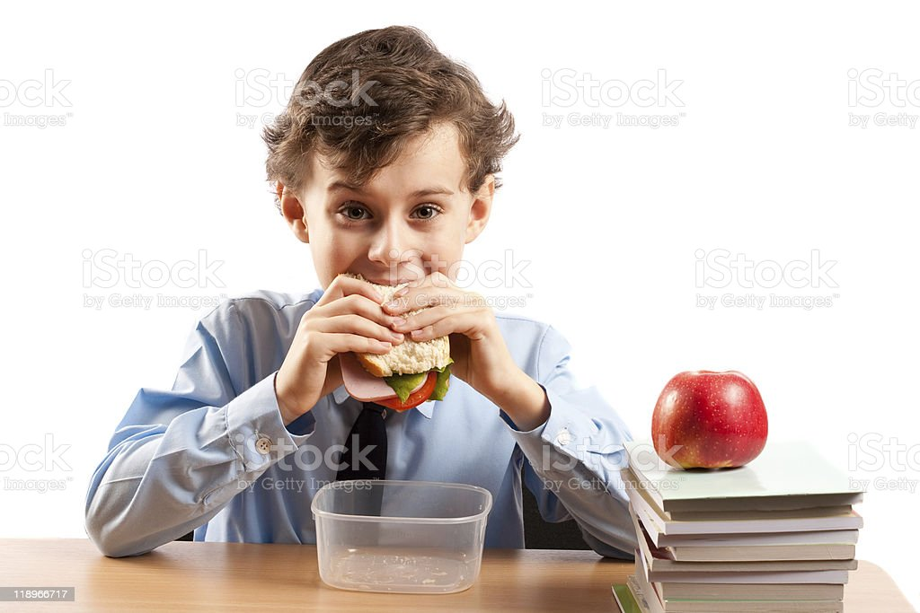 Schoolboy during lunch break royalty-free stock photo