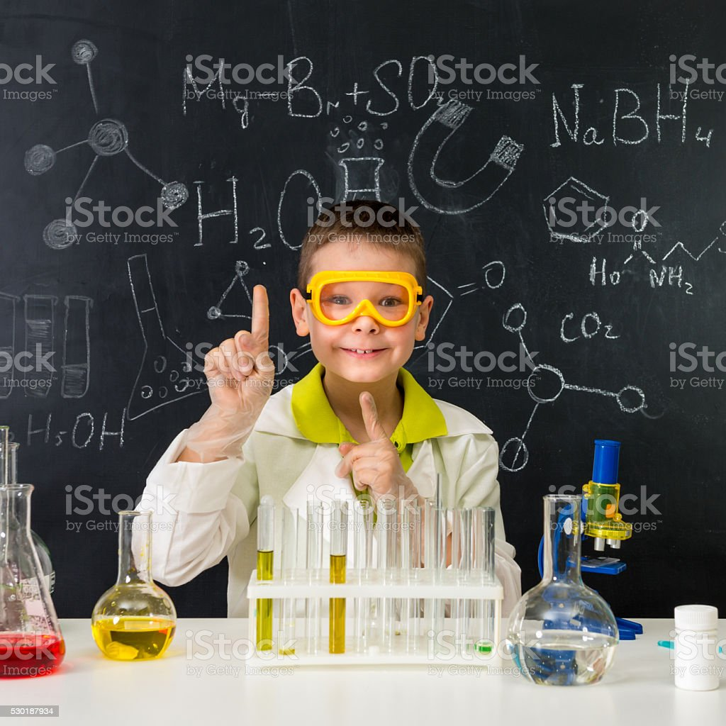 schoolboy in chemistry lab got an idea stock photo
