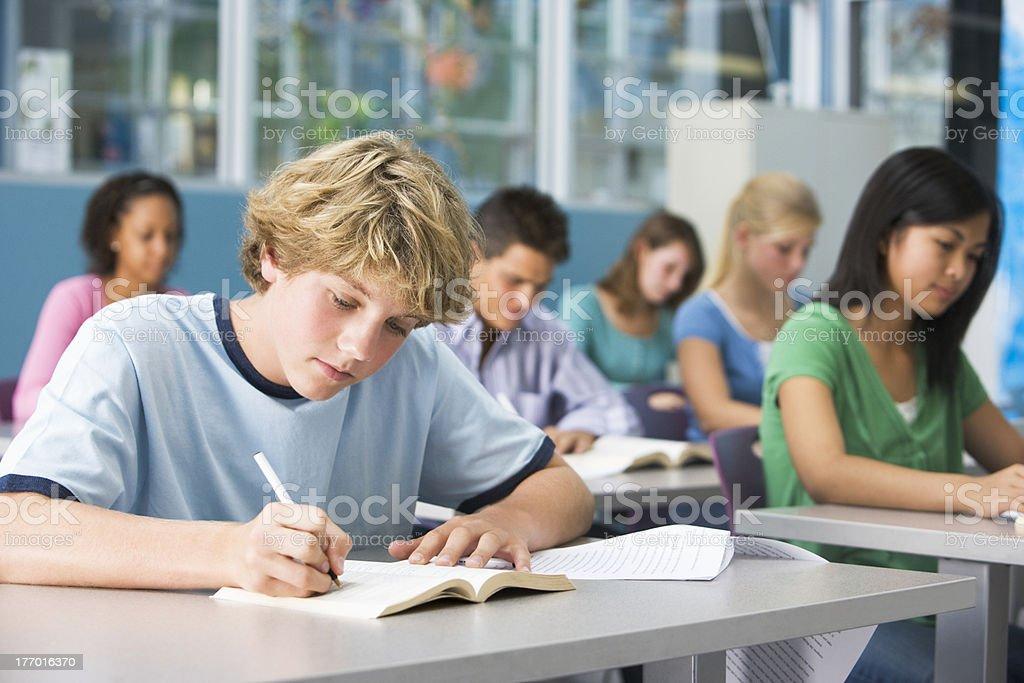 Schoolboy in high school class stock photo