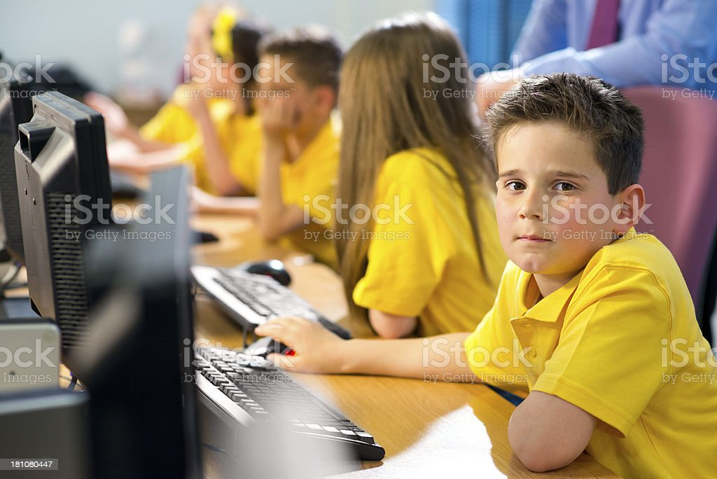 schoolboy in primary school IT class royalty-free stock photo