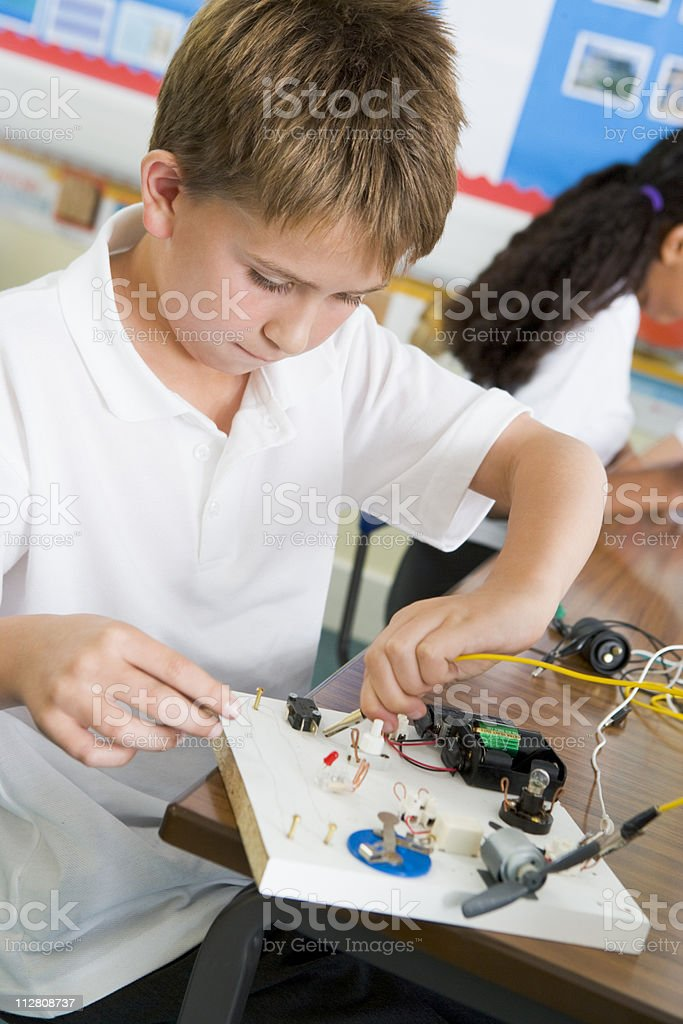 Schoolboy in science class stock photo