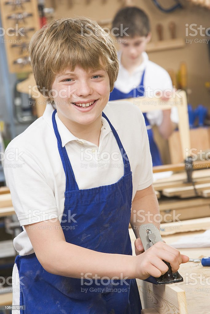 Schoolboy in woodwork class stock photo