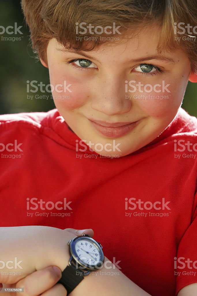 Schoolboy Learning to Tell Time two royalty-free stock photo